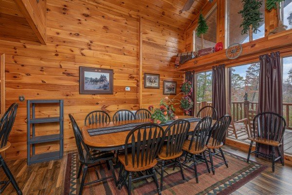 Dining table for 10 at True Grit, a 5 bedroom cabin rental located in Pigeon Forge