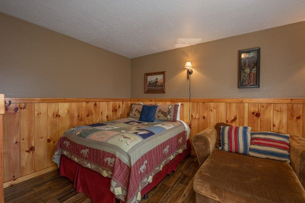 Bedroom with a bed and daybed at True Grit, a 5 bedroom cabin rental located in Pigeon Forge