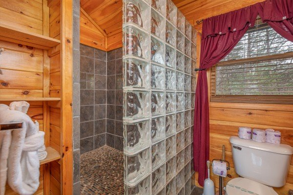 Custom tile and glass shower at True Grit, a 5 bedroom cabin rental located in Pigeon Forge