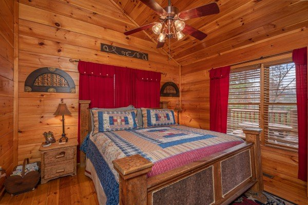 Bedroom with two night stands and lamps at True Grit, a 5 bedroom cabin rental located in Pigeon Forge