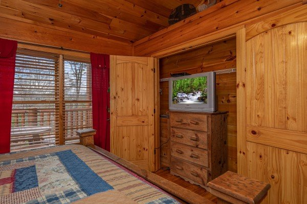 Dresser and TV in a closet at True Grit, a 5 bedroom cabin rental located in Pigeon Forge