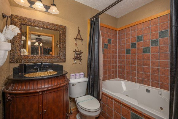 Bathroom with a jacuzzi at True Grit, a 5 bedroom cabin rental located in Pigeon Forge