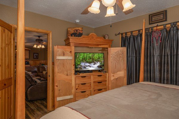 Armoire with TV at True Grit, a 5 bedroom cabin rental located in Pigeon Forge
