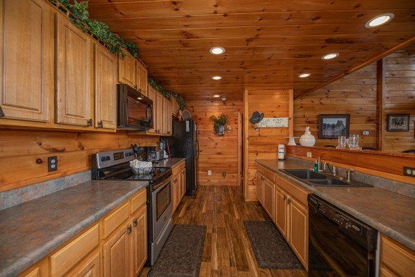 Galley kitchen at True Grit, a 5 bedroom cabin rental located in Pigeon Forge