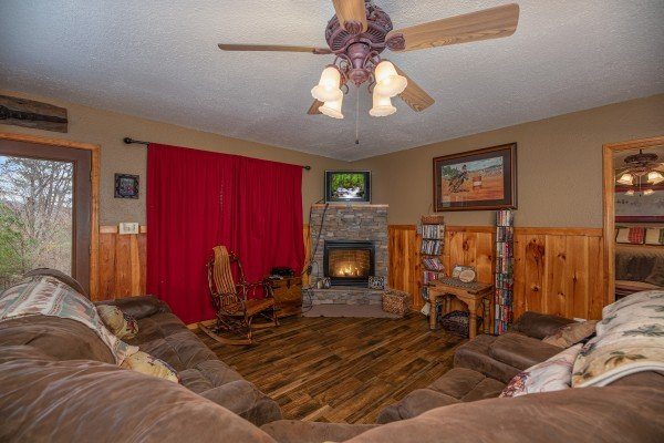 TV and fireplace at True Grit, a 5 bedroom cabin rental located in Pigeon Forge
