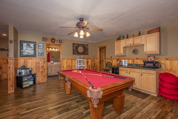 Pool table and kitchenette at True Grit, a 5 bedroom cabin rental located in Pigeon Forge