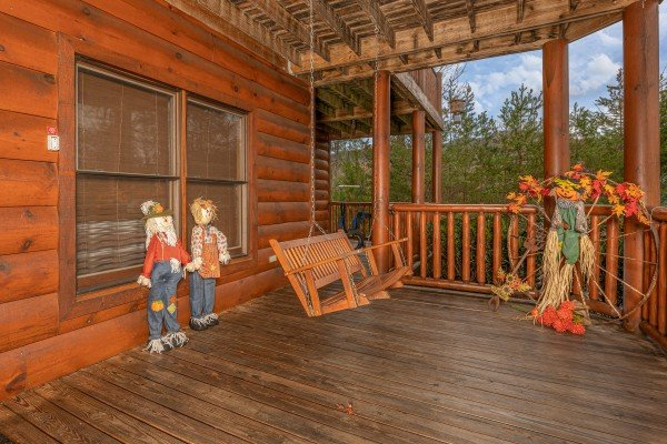 Swing on a porch at True Grit, a 5 bedroom cabin rental located in Pigeon Forge