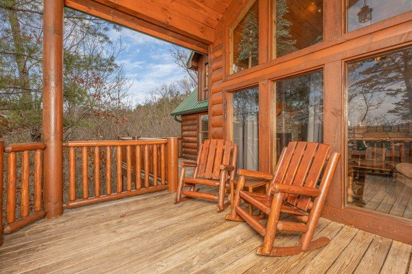 Rocking chairs on the deck at True Grit, a 5 bedroom cabin rental located in Pigeon Forge