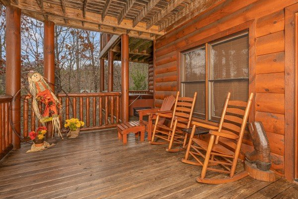 Rocking chairs on a screened porch at True Grit, a 5 bedroom cabin rental located in Pigeon Forge