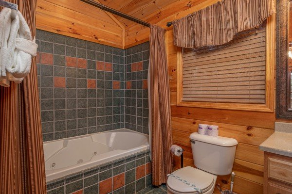 Bathroom with jacuzzi at True Grit, a 5 bedroom cabin rental located in Pigeon Forge