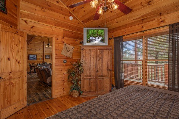 Armoire and TV in a bedroom at True Grit, a 5 bedroom cabin rental located in Pigeon Forge