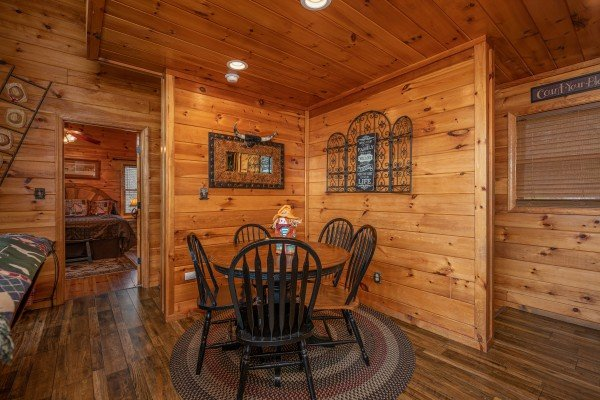 Dining space for five at True Grit, a 5 bedroom cabin rental located in Pigeon Forge