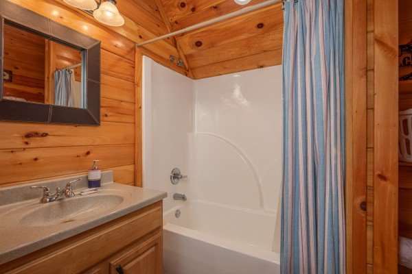 Tub and shower at True Grit, a 5 bedroom cabin rental located in Pigeon Forge