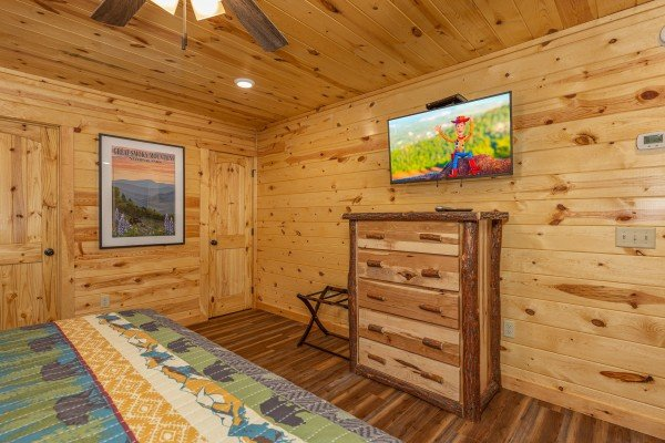 Dresser and TV in a bedroom at Pool & a View, a 2 bedroom cabin rental located in Gatlinburg