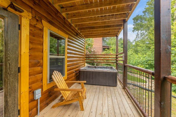 Covered deck and hot tub at Pool & a View, a 2 bedroom cabin rental located in Gatlinburg