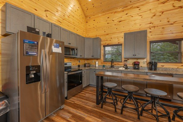 Kitchen with stainless appliances and a breakfast bar at Pool & a View, a 2 bedroom cabin rental located in Gatlinburg