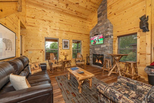 Living room with fireplace and TV at Pool & a View, a 2 bedroom cabin rental located in Gatlinburg