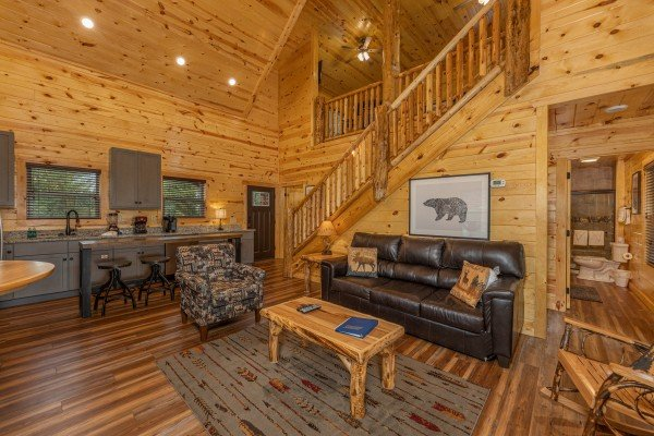 Sofa and chair in a living room at Pool & a View, a 2 bedroom cabin rental located in Gatlinburg