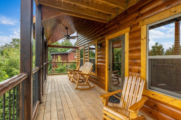 Rocking chairs on a covered deck at Pool & a View, a 2 bedroom cabin rental located in Gatlinburg