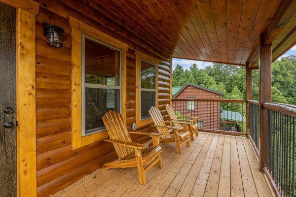 Chairs on a covered deck at Pool & a View, a 2 bedroom cabin rental located in Gatlinburg