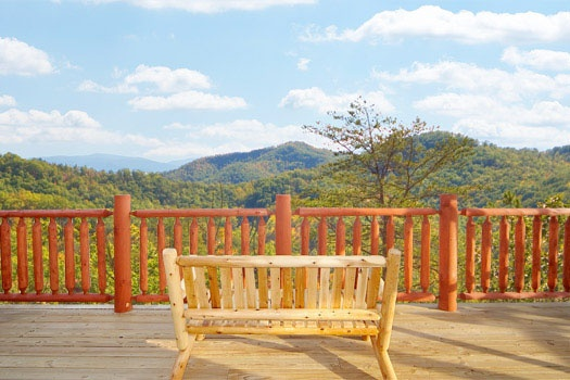 deck bench with smoky mountain view at mountain wonderland a 3 bedroom cabin rental located in pigeon forge