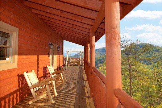 front porch with rocking chairs and swing at mountain wonderland a 3 bedroom cabin rental located in pigeon forge