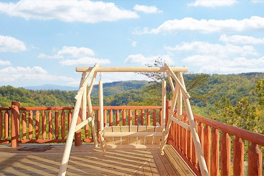 swing with view of the smoky mountains at mountain wonderland a 3 bedroom cabin rental located in pigeon forge