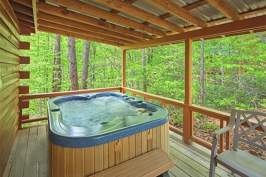 covered porch with hot tub at sunshine day dream a 1 bedroom cabin rental located in gatlinburg