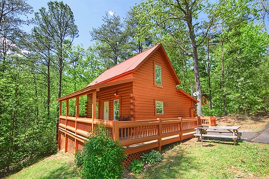 exterior view at sunshine day dream a 1 bedroom cabin rental located in gatlinburg
