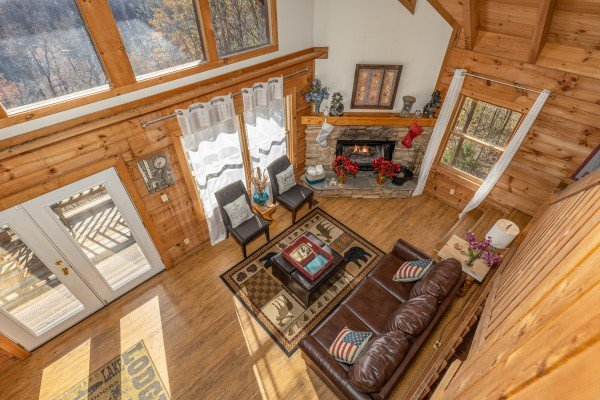 Looking down at the living room at Brink of Heaven, a 2 bedroom cabin rental located in Gatlinburg