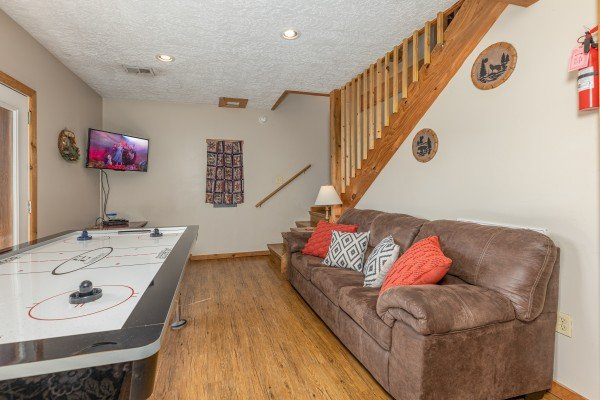 Air hockey table and TV at Brink of Heaven, a 2 bedroom cabin rental located in Gatlinburg