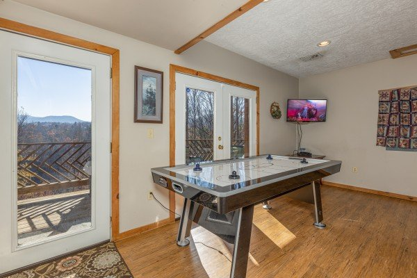 Air hockey and TV at Brink of Heaven, a 2 bedroom cabin rental located in Gatlinburg