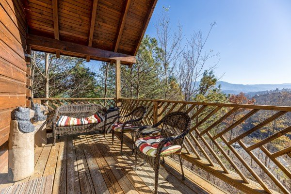 Seating on a covered deck at Brink of Heaven, a 2 bedroom cabin rental located in Gatlinburg