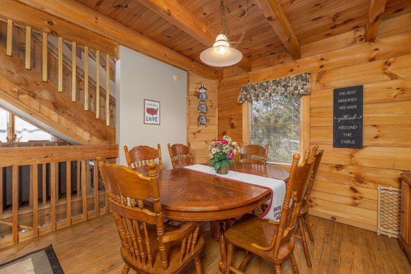 Dining table for six at Brink of Heaven, a 2 bedroom cabin rental located in Gatlinburg
