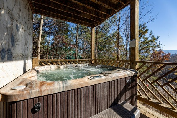 Hot tub on a deck at Brink of Heaven, a 2 bedroom cabin rental located in Gatlinburg