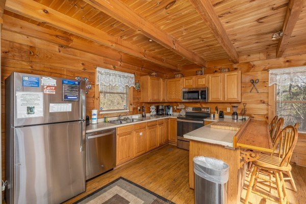 Kitchen with stainless appliances and breakfast bar at Brink of Heaven, a 2 bedroom cabin rental located in Gatlinburg