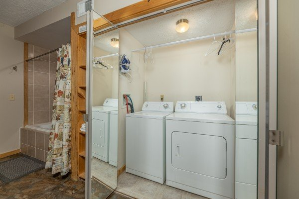 Full washer and dryer in a laundry closet at Brink of Heaven, a 2 bedroom cabin rental located in Gatlinburg