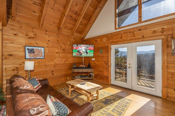 Living room with TV and mountain view at Brink of Heaven, a 2 bedroom cabin rental located in Gatlinburg