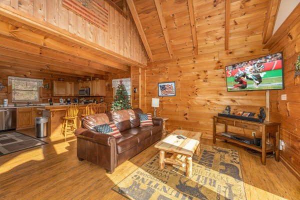 Sofa and TV in the living room at Brink of Heaven, a 2 bedroom cabin rental located in Gatlinburg