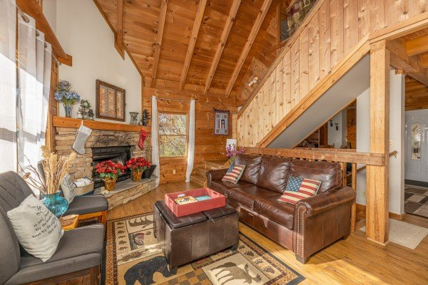 Fireplace, sofa, and two chairs in the living room at Brink of Heaven, a 2 bedroom cabin rental located in Gatlinburg