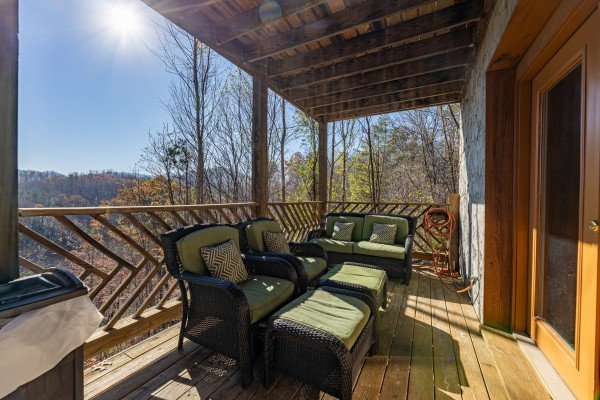 Seating on the lower deck at Brink of Heaven, a 2 bedroom cabin rental located in Gatlinburg