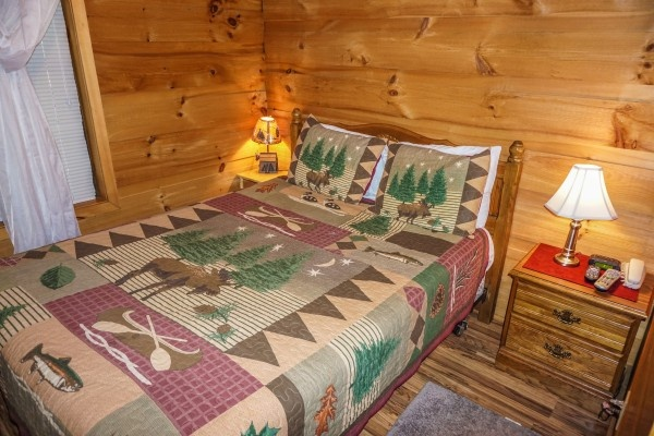 Queen-sized bed in bedroom at Cozy Cabin, a 2-bedroom cabin rental located in Gatlinburg