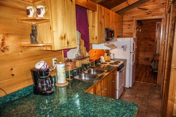 kitchen at cozy cabin a 2 bedroom cabin rental located in gatlinburg