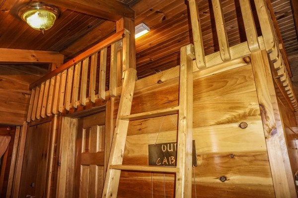 ladder up to loft at cozy cabin a 2 bedroom cabin rental located in gatlinburg