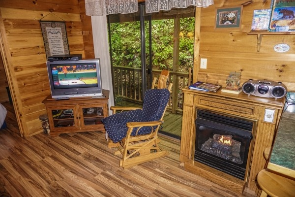Fireplace in the living room at Cozy Cabin, a 2-bedroom cabin rental located in Gatlinburg
