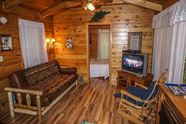 Living room seating at Cozy Cabin, a 2-bedroom cabin rental located in Gatlinburg