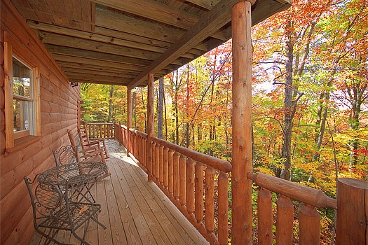 Back deck table and rockers at Tucked Away, a 2 bedroom cabin rental located in Gatlinburg