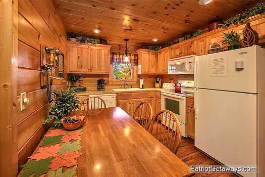 kitchen with eat in dining at tucked away a 2 bedroom cabin rental located in gatlinburg