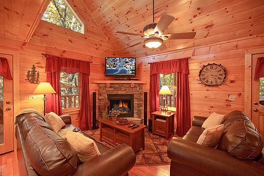 living room with fireplace at tucked away a 2 bedroom cabin rental located in gatlinburg