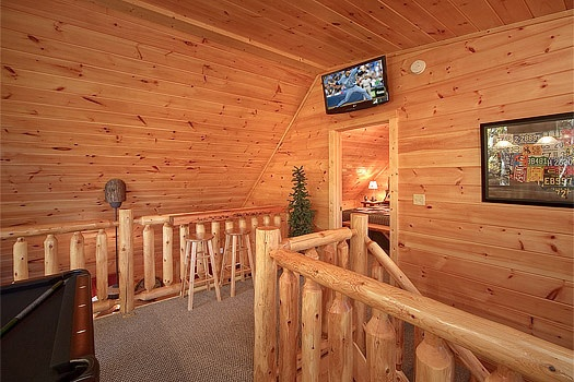 Lofted game room TV at Tucked Away, a 2 bedroom cabin rental located in Gatlinburg